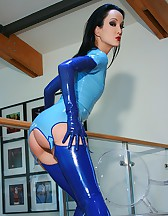 Riding a big dildo in blue latex