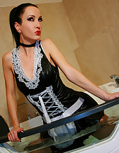 French maid plays in the bathtub