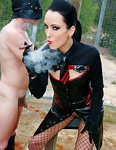 Cigar smoking Mistress uses slave