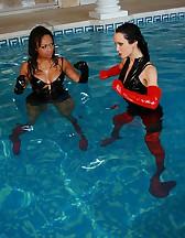 Wet lesbian catfight in shiny PVC