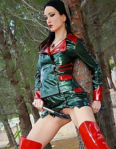 Mistress in glossy plastic outfit