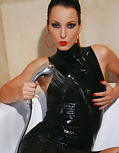 Soaking wet in tight black rubber