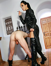 Leather Domina uses sub as ashtray
