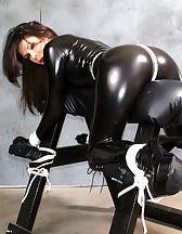 Latex slave in bondage