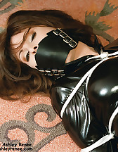 Latex model tied and gagged