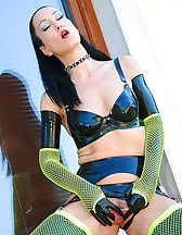 Kinky in black latex and fishnets