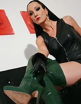 Horny in green leather boots