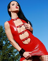 Latex and fishnets tease