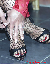 Footjob in fishnets, pic #7