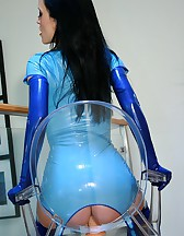 Riding a big dildo in blue latex, pic #12