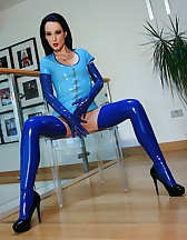 Riding a big dildo in blue latex, pic #4