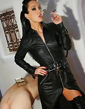 Leather Domina uses sub as ashtray, pic #11