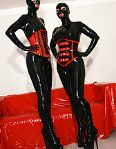 Horny lesbian hooded rubber dolls, pic #1