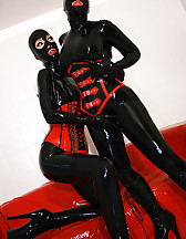 Horny lesbian hooded rubber dolls, pic #7