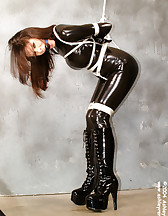 Latex slave in bondage, pic #9